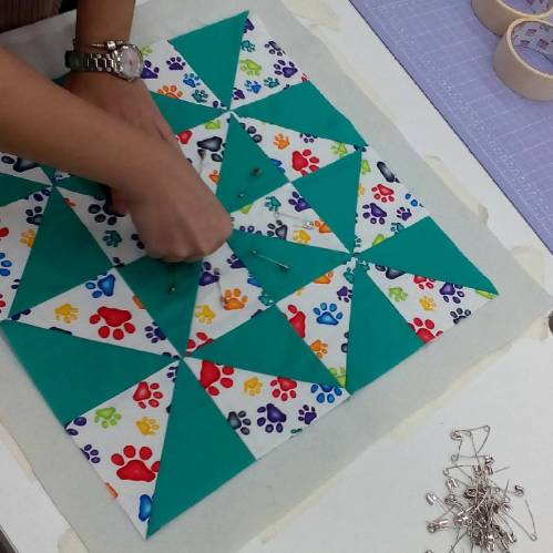 The start of my BoM classes at Spotlight. Pin basting the quilt top.
